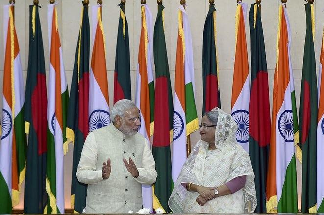 Modi with Bangladeshi Prime Minister Sheikh Hasina during the Land Boundary Agreement signing ceremony (Photo credits: MUNIR UZ ZAMAN/AFP/Getty Images)
